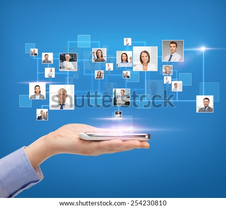 business, people, technology and communication concept - close up of woman hand with smartphone over blue background with icons of contacts - stock photo