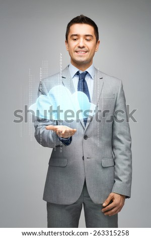 business, people, technology and computing concept - happy businessman in suit showing or holding virtual cloud projection on palm over gray background - stock photo