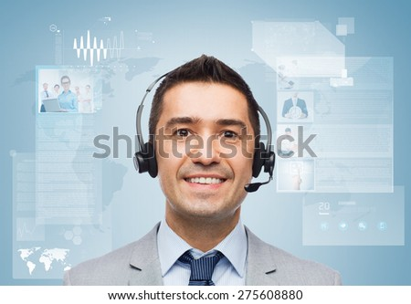 business, people, technology and service concept - smiling businessman in headset over blue background with world map and virtual screens - stock photo