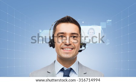 business, people, technology and service concept - smiling businessman in headset over blue background with virtual screens - stock photo
