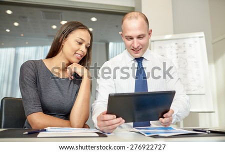 business, people, technology and teamwork concept - smiling businessman and businesswoman with tablet pc computer meeting in office