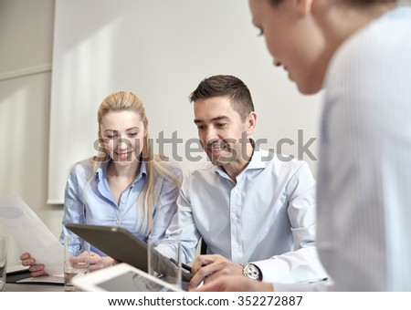 business, people, technology and teamwork concept - smiling businessman and businesswomen with tablet pc computer meeting in office