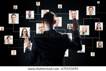 business, people, technology, employment and hiring concept - businessman in suit working with virtual contact icons over black background