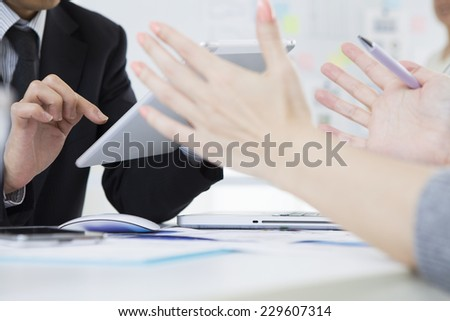 Business people to the meeting - stock photo