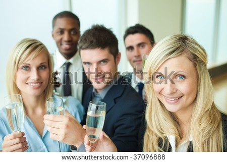 Business people toasting with champagne in an office