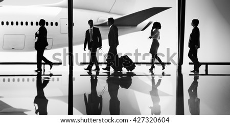 Business People Traveling Airport Terminal Walking Concept - stock photo