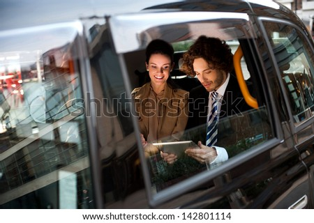 Business people travellng around the city. - stock photo