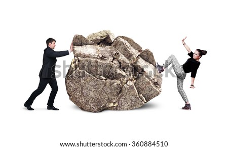 Business people try to move the big stone - stock photo