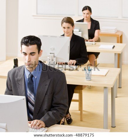 Business people typing on computer - stock photo