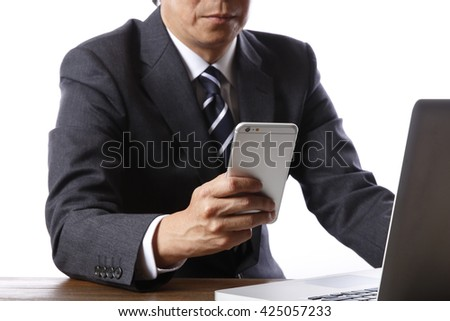 Business people use smart phones