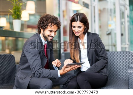 Business people using a digital tablet in a business environment - stock photo