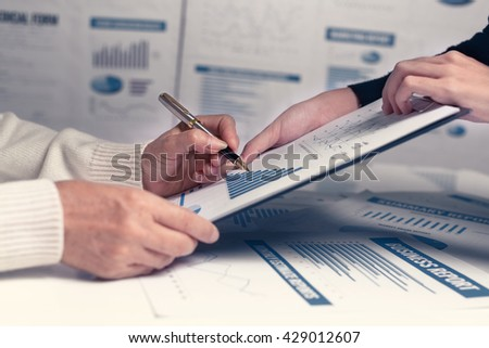 Business people using accounting reports and charts discussing and shows the profit results for successful.