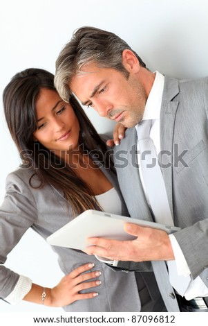 Business people using electronic tablet - stock photo