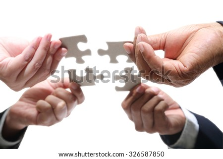 Business people using jigsaw puzzle for joy with team partnership included clipping path - stock photo