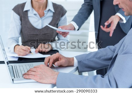 Business people using laptop in the office