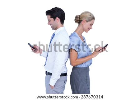 Business people using smartphone back to back on white background