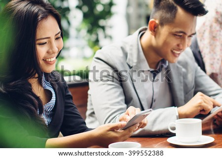 business people using smartphone gadget while having a coffee break at cafe - stock photo