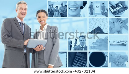 Business people using tablet computer against windows overlooking city - stock photo
