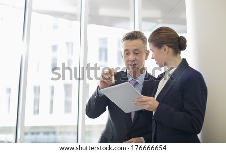 Business people using tablet PC in office