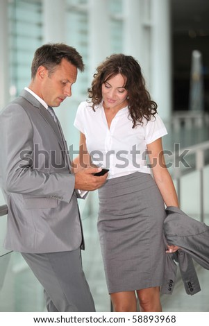 Business people waiting at the airport - stock photo