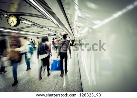 business people walk at subway station abstract blur - stock photo