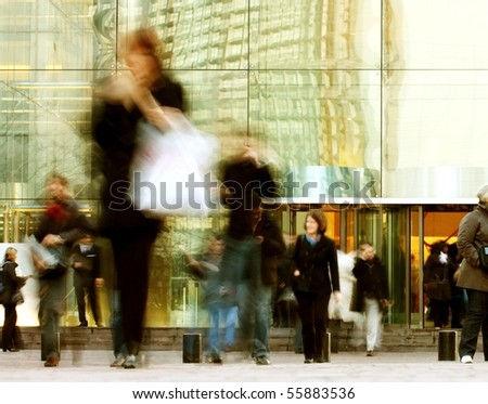 Business people walking along office building