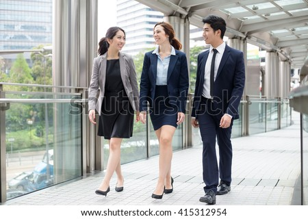 Business people walking at outdoor - stock photo