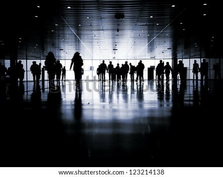 business people walking down the street talking. Silhouettes. - stock photo