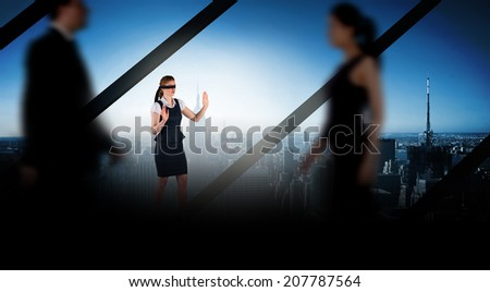 Business people walking in a blur against room with large window looking on city - stock photo