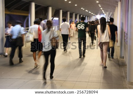 business people walking in blur motion