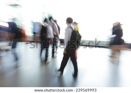 Business people walking in the city in motion blur
