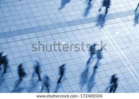 business people walking in the street  at rush hour - stock photo