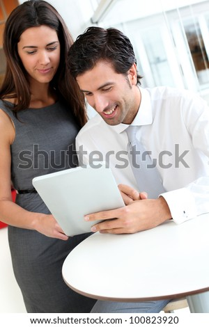 Business people websurfing on tablet during breaktime - stock photo