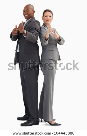 Business people who have their thumbs up - stock photo