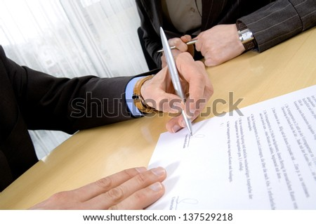 Business people with contract - stock photo