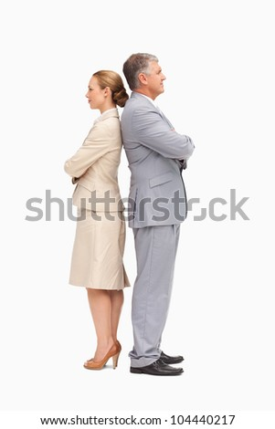 Business people with folded arms back to back against white background