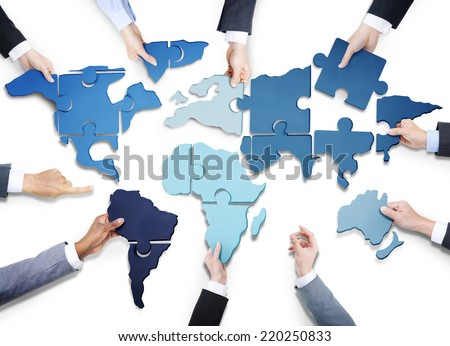 Business people jigsaw puzzle forming world stock photo royalty business people with jigsaw puzzle forming world map gumiabroncs Gallery