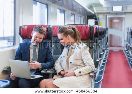 Business people with laptop in a train