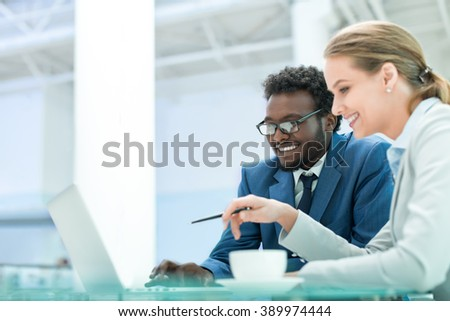 Business people with laptop in office - stock photo