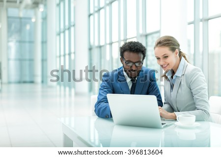 Business people with laptop in office