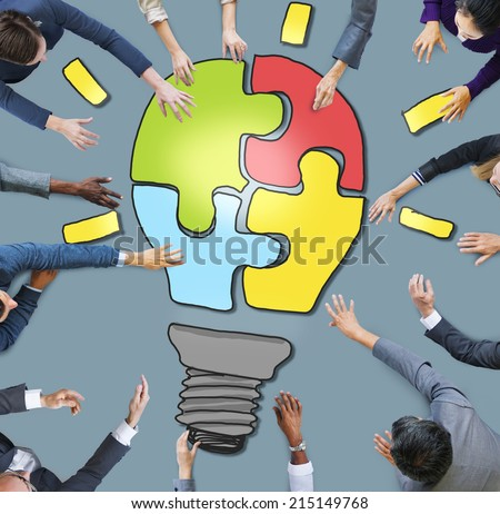 Business People with Light Bulb Jigsaw Symbol - stock photo