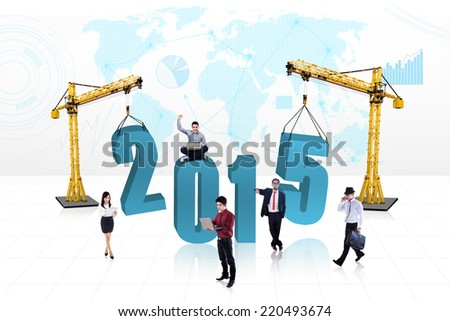 Business people with two cranes build number 2015, symbolizing people build future - stock photo