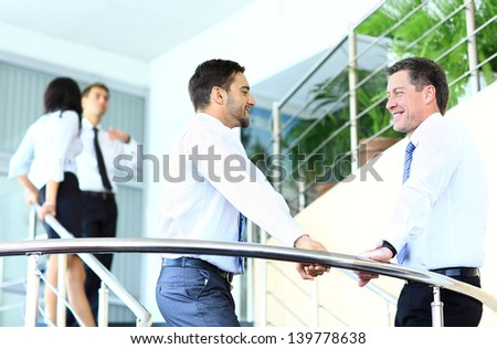 Business people working and discussing together at meeting in office - stock photo