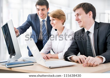 Business people working at a computers in the office - stock photo