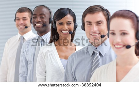 Business people working in a call center standing in a line