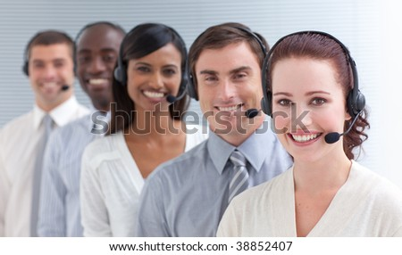 Business people working in a call center standing in a line - stock photo