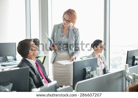 Business people working in an open plan office