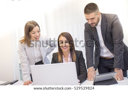 Business people working in group in the office.Young business people working on lap top. Business and office concept.