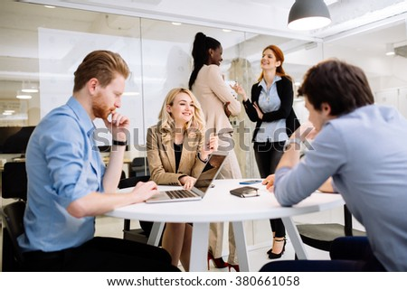Business people working in modern office - stock photo