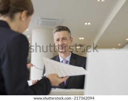 Business people working in office cafeteria - stock photo